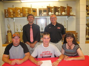 Portsmouth West High's Daulton Kenyon poses with coaches and his parents after signing to play baseball at Rio Grande